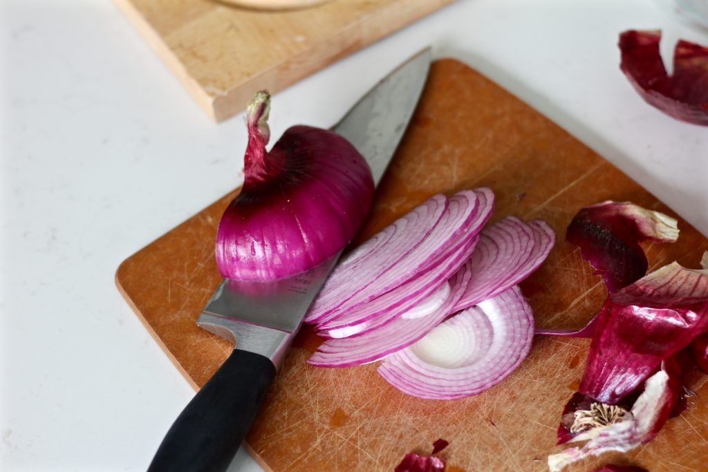 Thinly slice 1/2 a red onion.
