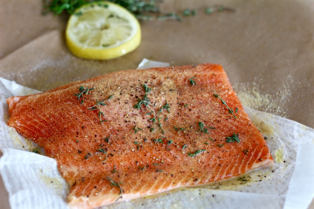 Seasoned salmon filet ready to grill.